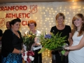 Fidelma Murray presenting Teresa Giles with a bouquet of flo
