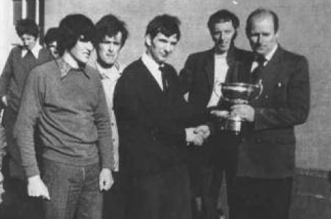 L-R- Joe Boyce, Patsy McGonagle and Neily McDaid Front- Eamon Giles being presented with the Cup