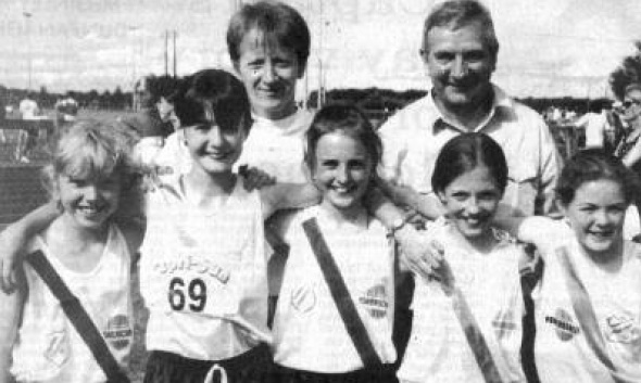 In August Cranford U/11 girls relay team broke the Irish record for the 4 x 100 meters. Team members were L-R: Tara McElhinney, Louise Peoples, Labhaoise Gillespie, Zoe Speer and Dympna Gallagher pictured with Rose Gavaghan and Eamon Giles..