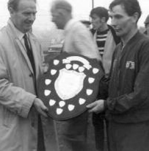 Left, Jim Vallelley presenting the Cardinal Dalton Shield to Eamon Giles