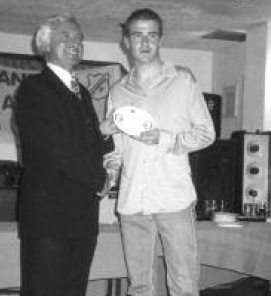 Minister for Sport Dr. James McDaid presents Karol Duggan with best juvenile boy athlete of the year, at Cranford Athletic Clubs presentation night, in Logues of Cranford 1999