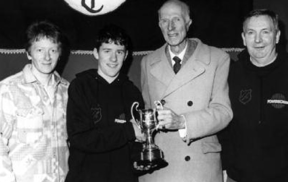 Sir Shane Lesley presenting the cup to John McClafferty for best overall club at the Glaslough road race pictured with Rose Gavaghan and Eamon Giles