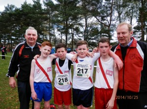 Eamon Giles and Ernie mc Elhiney with Johnny mc Groddy Dylan Dorrian Barry Donnelly and Eoin Moore u/14 Boys.