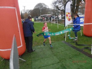 Oisin Kelly crossing the line in 1st place in the u/11 Boys.