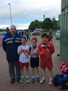 Eamon Giles with Oran 3rd Oisin 1st and Allan 2nd in the boys u/13 600m