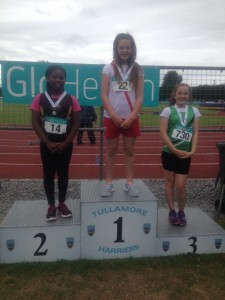 Aoife Giles receiving her medals.