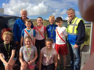 The u/13 and 15 medal winners with Brian and Noel McBride.