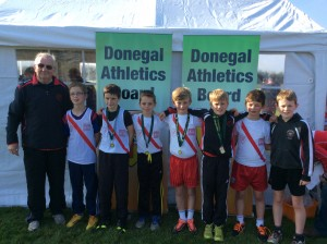 Boys U/12 with Eamon Giles. Gold medal winners.