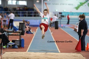 Oisin Kelly in the long jump.