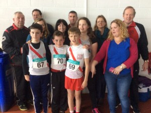 Liam Oisin Max Aoife with coaches and family.