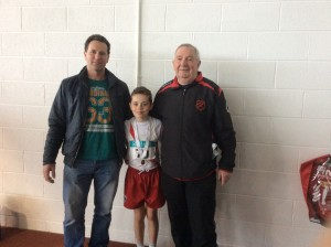 Oisin with his dad Tom and Coach Eamon.