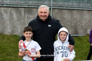 Eamon Giles with Caolan MC Fadden and Michael Moore.