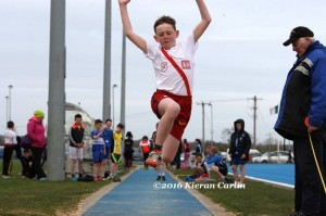 Johnny Trearty in the U/13 long jump.