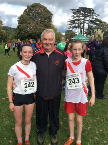 Molly Trearty and Hannah Logue with Eamon Giles.