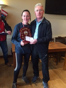 Bridie Trearty recieving her prize from Jerry Gallagher.