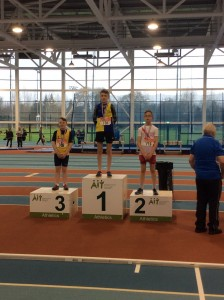 Connor Neely recieving his silver medal for the boys U/12 long jump.