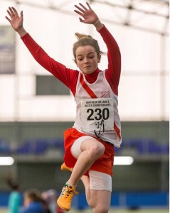 Teresa Mullen on her way to Gold in the long jump.