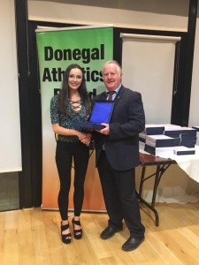 Molly Trearty recieving her award from Bernie Callaghan.