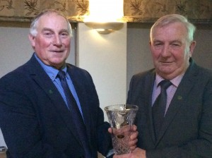 Eamon Giles presenting paddy Marley with an apperation award.