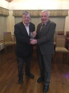 Danny Lafferty receiving his appreciation award from Eamon Giles