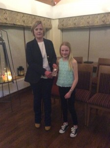 Miah Fletcher receiving her award from Annette Lafferty.