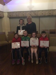 Cranford Ac Athletes receiving their certificates from Tara Fletcher