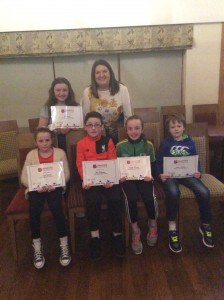 Cranford AC Athletes receiving their certificates from Claire Neely