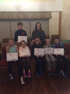 Cranford Ac Athletes receiving their certificates from Mairead Giles