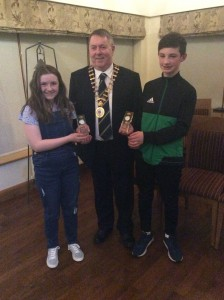 Orla Neely and Oran McMenamin receiving their award Cllr Jerry Mc Monnigle